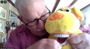 Schmerelson helps pooch keep his teeth clean.