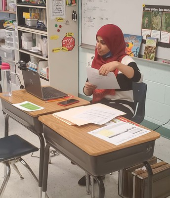 Ms. Rasheed showing student progress and excellent school work
